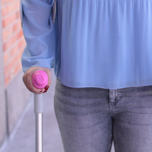 crutches with pink sleeve