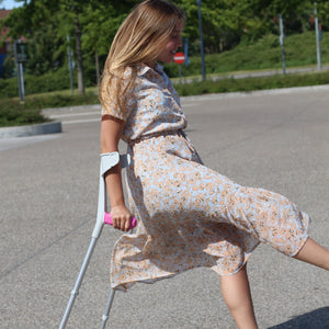 girl walking with crutches