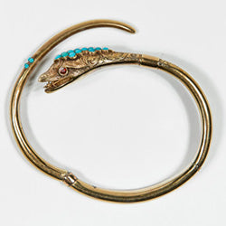 This is a gold-tone snake bracelet with an accompanying box owned by Catherine Dickens from around the 1840s - 1850s.