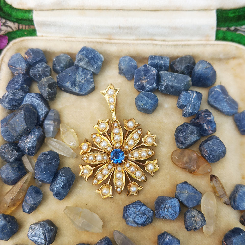 15ct gold antique pendant studded with blue sapphire