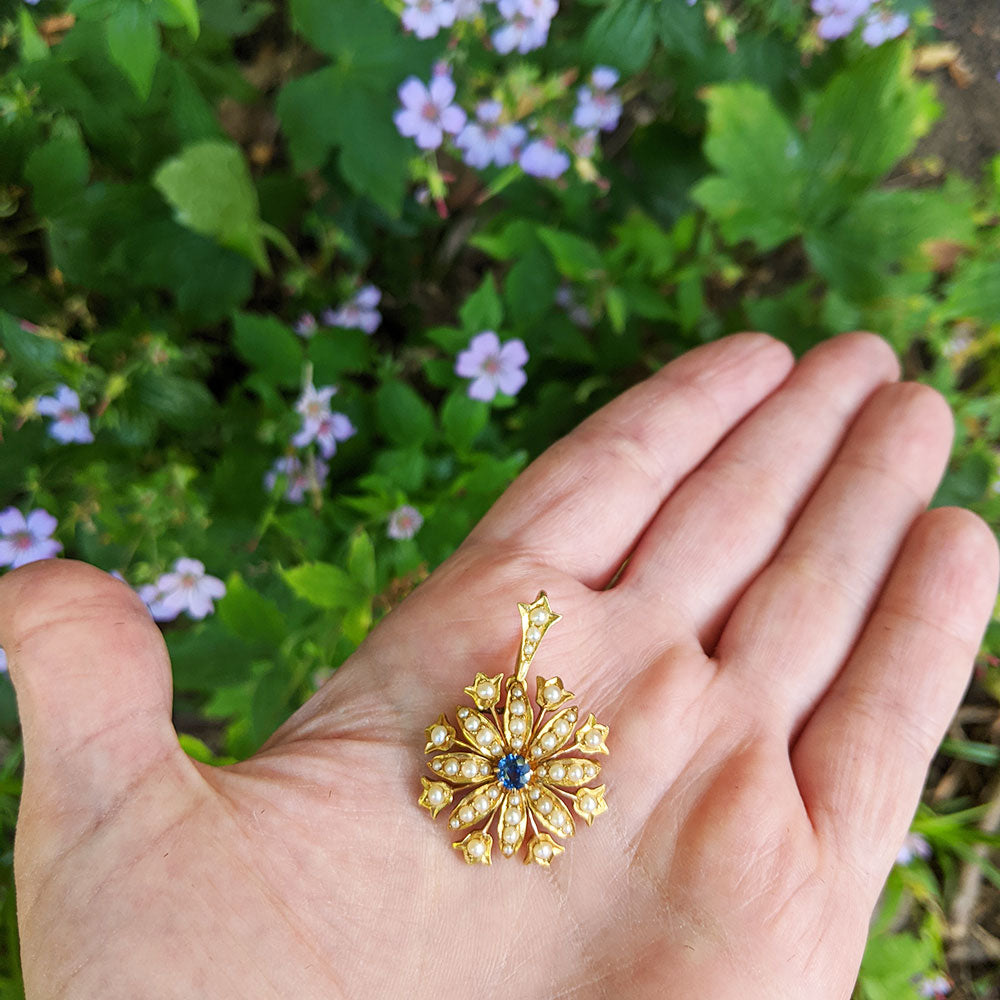 antique brooch in hand for scale