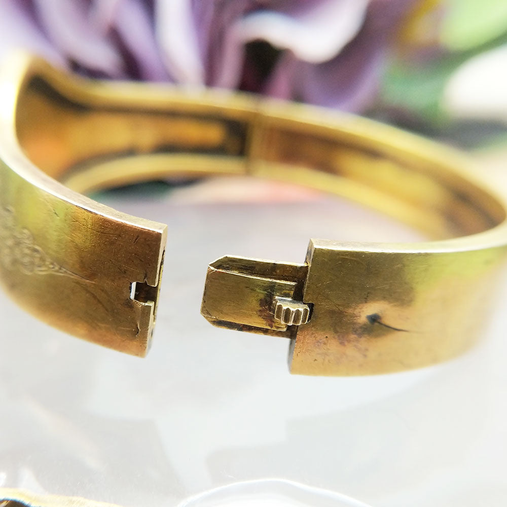secure catch mechanism on antique gold bangle