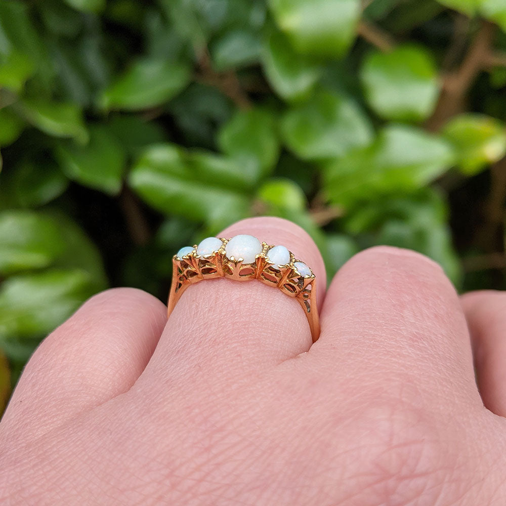 different view of opal ring on hand