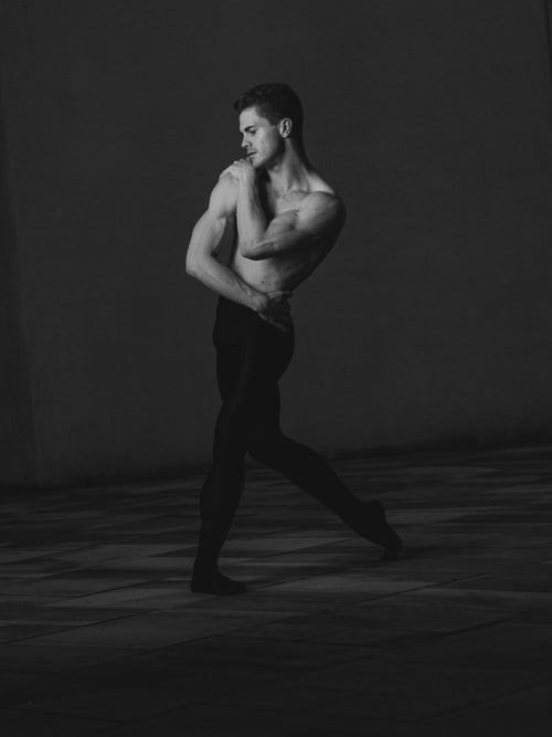 Rhys Yeomans, ballet dancer wearing black dance tights and has a bare torso