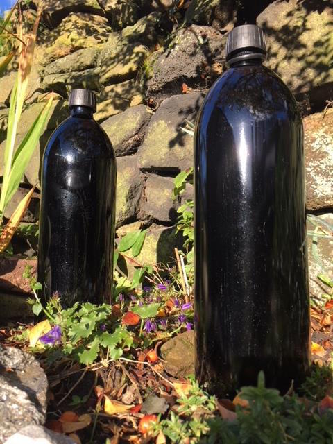 Miron bottles charging water in the sun