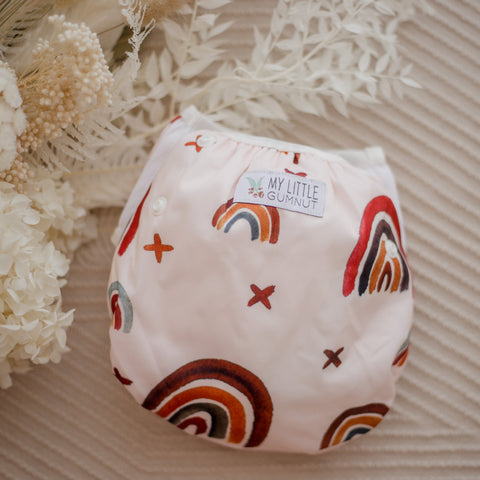 Rainbow earth tones swimming nappy. Australian artists designed swim nappy. My little gumnut.