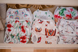 Collection of baby swimming nappies. Tropical oasis swimming nappy. Reusable swimming nappy. My little gumnut.