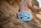 beach baby wearing a Whales cloth swimming nappy. Reusable swimming nappy. Australian artist design cloth nappy. My little gumnut.