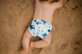 Beach baby wearing Marine Life Swimming Nappy. Reusable swimming nappy at the beach. My Little Gumnut.