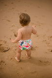 Baby wearing Tropical oasis swimming nappy. Reusable swimming nappy. My little gumnut.