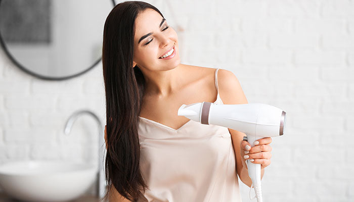 blow drying her hair