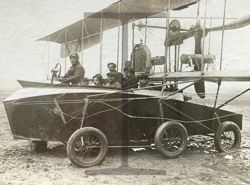 Rare Early Pusher Biplane with boat hull carrying passengers