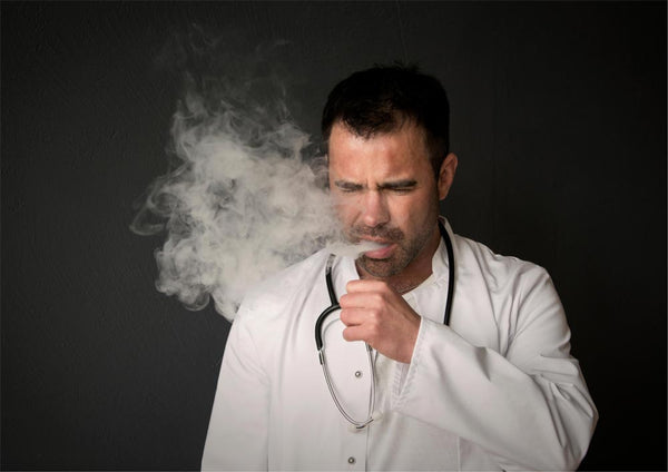 Man with stethoscope coughing. Don't vape on burnt vapour coils.