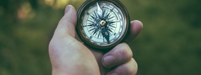 Image of man holding a compass