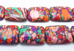 Vibrant Red and Pink Calsilica Pillow Beads