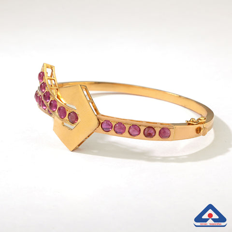22 karat gold knotted bracelet with rubies