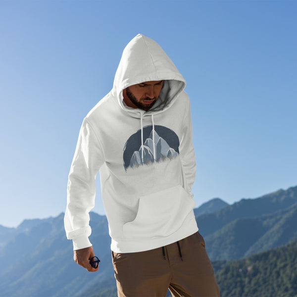 man wearing icy mountain forest hoodie on top of a mountain