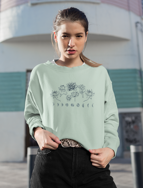 Woman Wearing Dusty Blue Lotus Flower Moon Phase Cropped Crew Sweatshirt