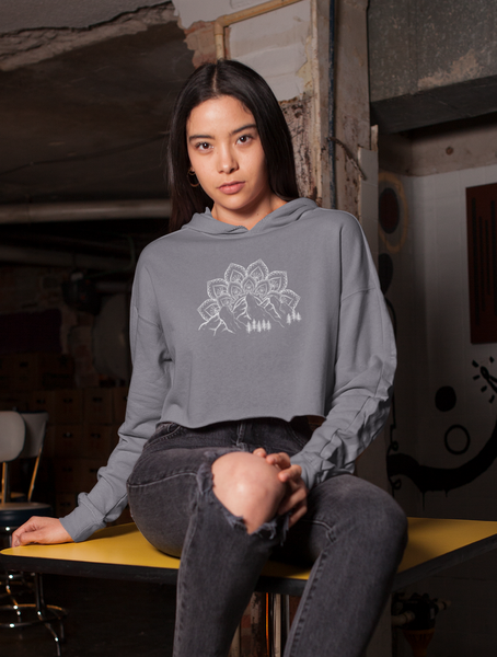 Woman in Garage Wearing Mountain, Mandala, and Evergreen Tree Hoodie Sweatshirt
