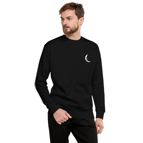Man wearing crescent moon and ivy crew black sweatshirt