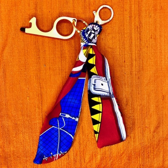 Authentic HERMES Vintage Couvertures et Tenues du Jour Silk Safe Scarf Charm exclusively at VintageLuxeUp.com