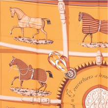 Load image into Gallery viewer, HERMES Vintage Couvertures et Tenues de Jour Gold Tobacco Silk Scarf Face Mask exclusively at VintageLuxeUp.com