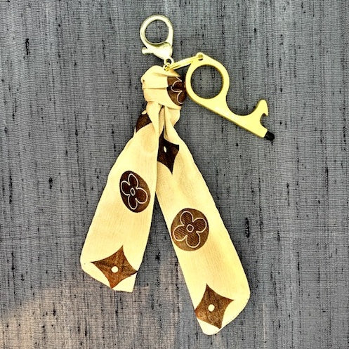 LOUIS VUITTON Vintage Silk Monogram Safe Hands Silk Scarf Charm™ exclusively at VintageLuxeUp.com
