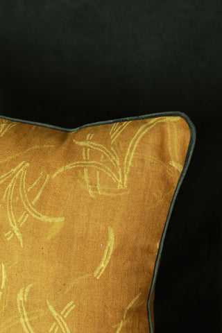 Textured (khadi) cushion cover with vibrant yellow hand block print