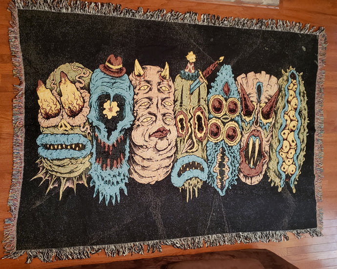 7 Monster Heads in a Row Blanket