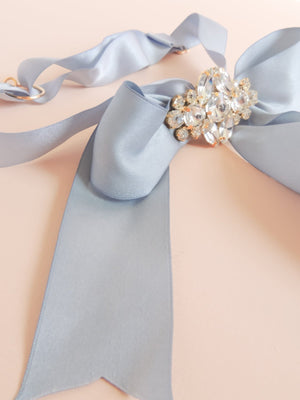 Mamie and James Amelie adjustable silk bow wedding garter in french blue with rhinestone appliqué in gold tone setting
