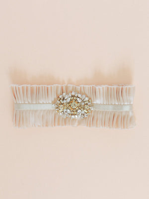 Mamie and James Charlotte silk charmeuse adjustable wedding garter with nude stretch banding and antique rose silk charmeuse with rhinestone appliqué in a gold tone setting