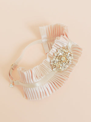 Mamie + James Charlotte silk charmeuse adjustable wedding garter with nude stretch banding and antique rose silk charmeuse with rhinestone appliqué in a gold tone setting