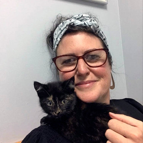 Image of Julia with a black kitten