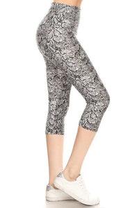 Yoga Style Banded Lined Snakeskin Printed Knit Capri Legging With High Waist