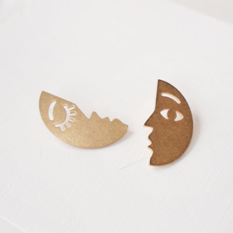 Gold Toned Paired Face Earrings
