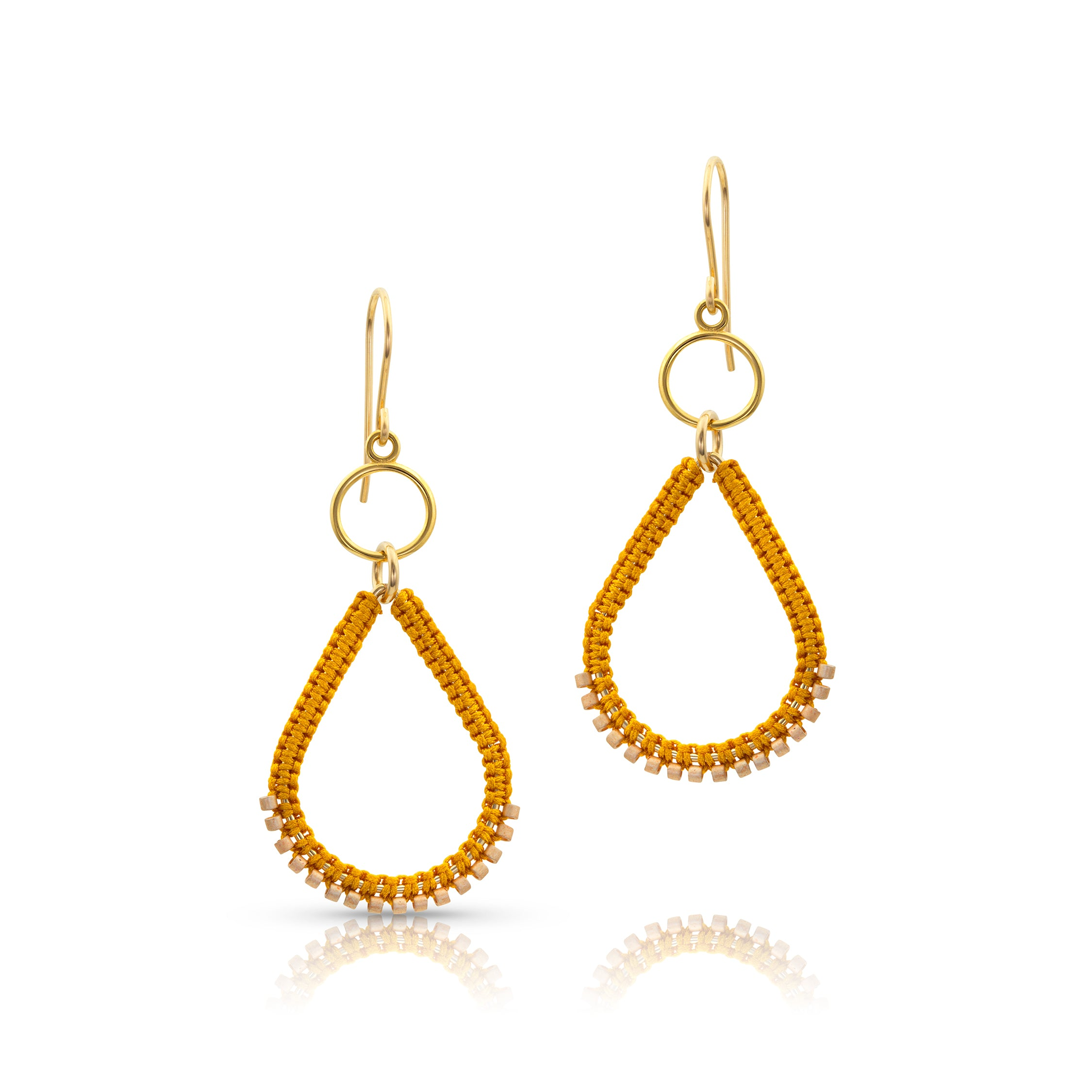 Gold filled components and a stylishly shaped teardrop enhanced with bead silk knotting create a beautiful combination of texture.