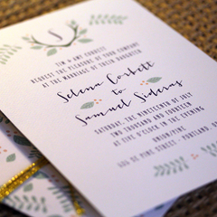 Natural wreath with initial wedding invitation suite