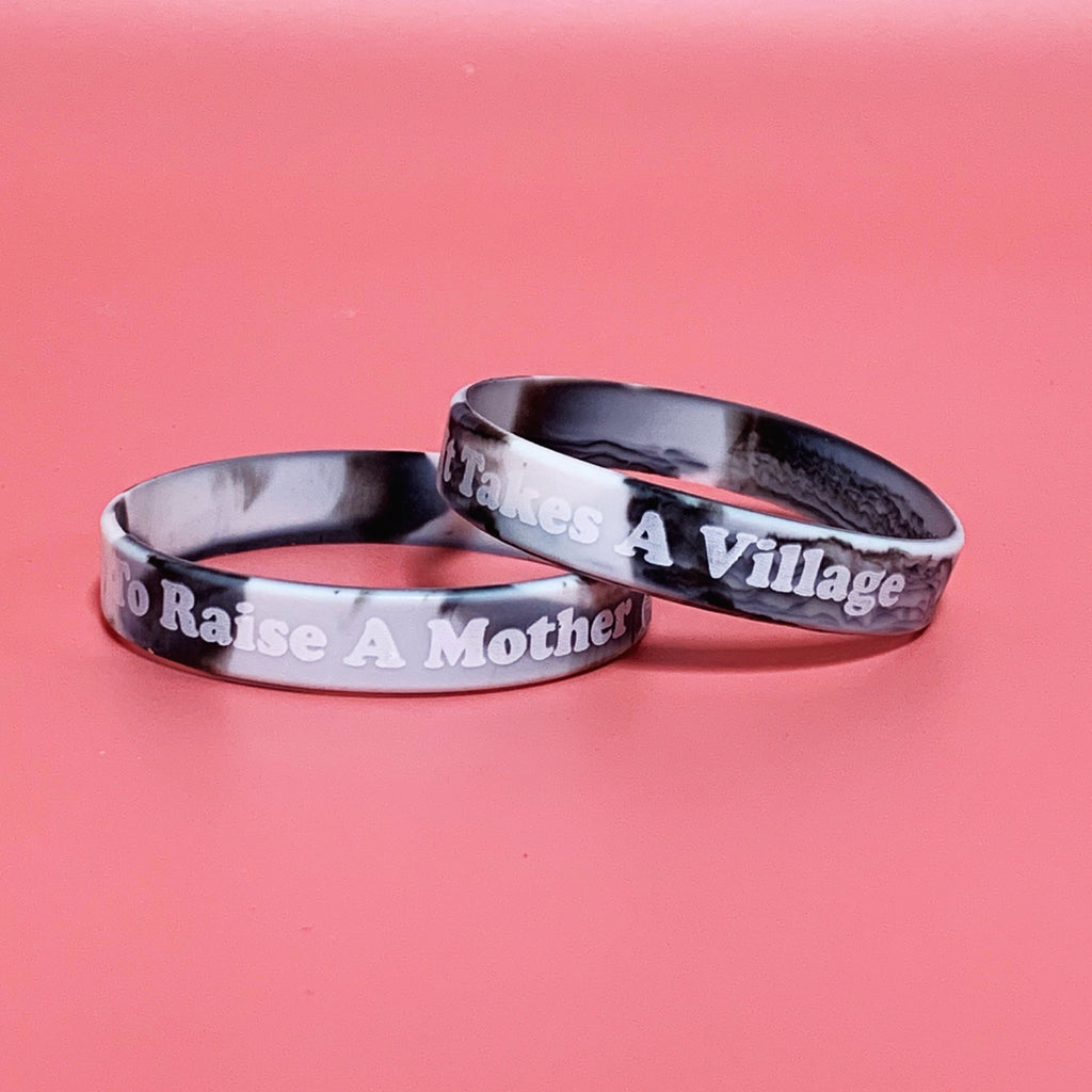 """It takes a Village to Raise a Mother ©"" Silicone Wristband"