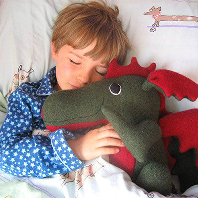 Green and red dragon asleep with small boy by cdbdi