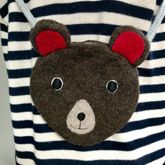 CDBDI Children's bear hand bag on a stripy jumper.