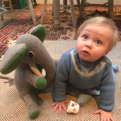 Boy with grey and green medium sized elephant by cdbdi