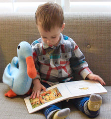 small boy with blue duck