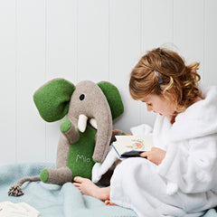 elephant with green ears being read to by cdbdi