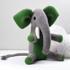 medium sized elephant with green ears by cdbdi