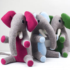 Medium sized elephants in green, pink and blue