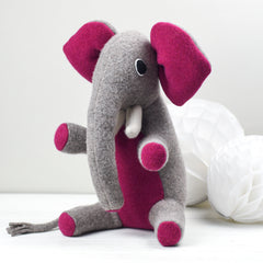 medium sized elephant with pink ears by cdbdi