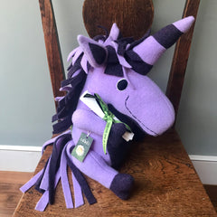 Purple unicorn on chair with scroll by cdbdi
