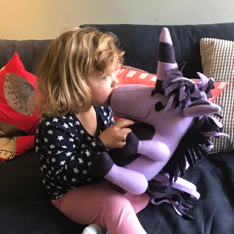 small girl with purple unicorn by cdbdi