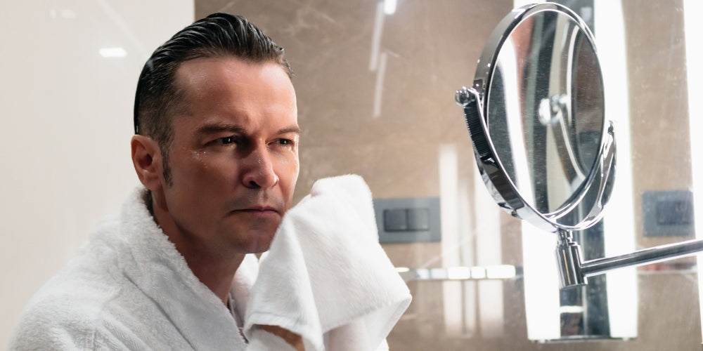 man with a clean shaved uses preshave oil
