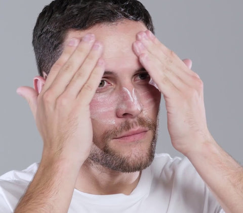 man using facial scrub
